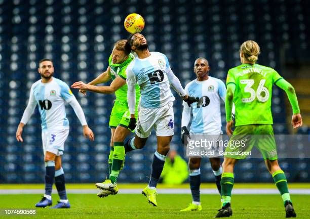 Blackburn Rovers' Kasey Palmer battles with Norwich City's Jordan Rhodes during the Sky Bet Championship match between Blackburn Rovers and Norwich...
