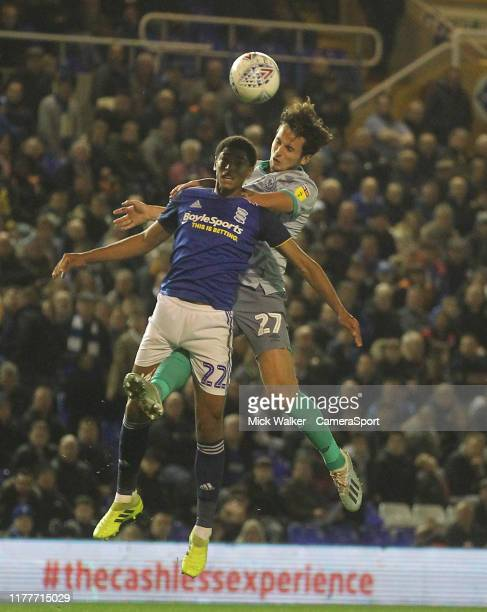 Blackburn Rovers Lewis Travis jumps with Birmingham City's Jude Bellingham during the Sky Bet Championship match between Birmingham City and...