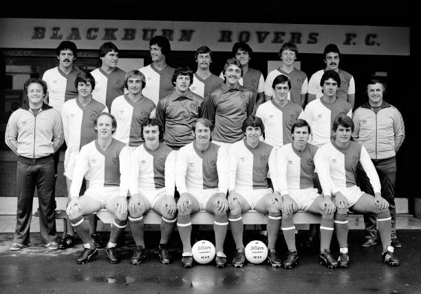 Blackburn Rovers line up for a team photograph outside the entrance to Ewood Park in Blackburn, England, circa August 1980 Back row : Mick Rathbone,...
