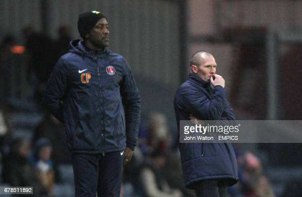 Blackburn Rovers' manager Michael Appleton looks on concerned alongside Charlton Athletic's manager Chris Powell