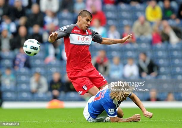 Blackburn Rovers' Michel Salgado tackles Fulham's Carlos Salcido