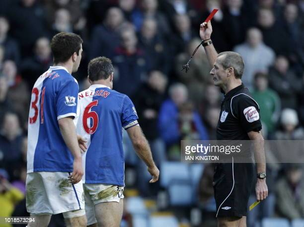 Blackburn Rovers' New Zealand defender Ryan Nelsen is sent off by referee Martin Atkinson during the English Premier League football match between...