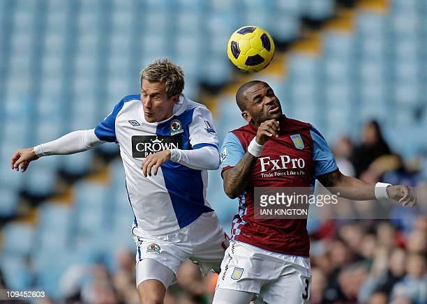 Blackburn Rovers' Norwegian midfielder Morten Gamst Pedersen vies with Aston Villa's English striker Darren Bent during the English Premier League...