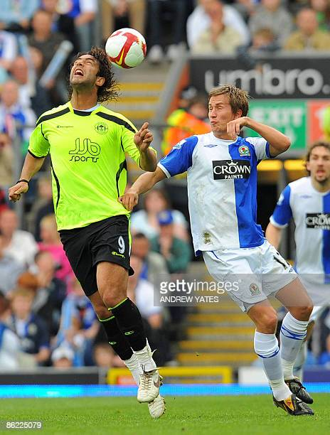 Blackburn Rovers' Norweigan midfielder Morten Gamst Pedersen vies with Wigan Athletic's Egyptian forward Mido during the Premier league football...