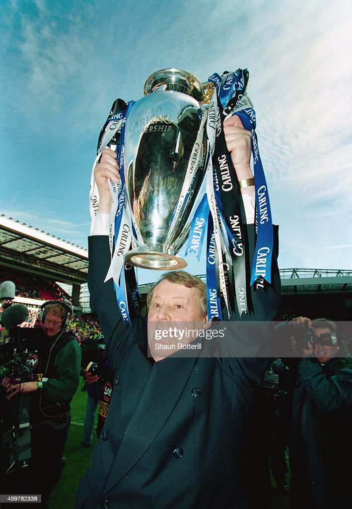 Blackburn Rovers owner Jack Walker, holds aloft the FA Carling Premiership trophy after the match between Liverpool and Blackburn Rovers at Anfield on May 14, 1995 in Liverpool, England.