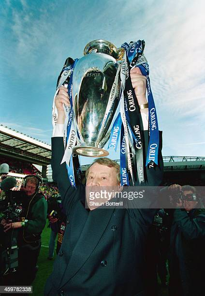Blackburn Rovers owner Jack Walker holds aloft the FA Carling Premiership trophy after the match between Liverpool and Blackburn Rovers at Anfield on...