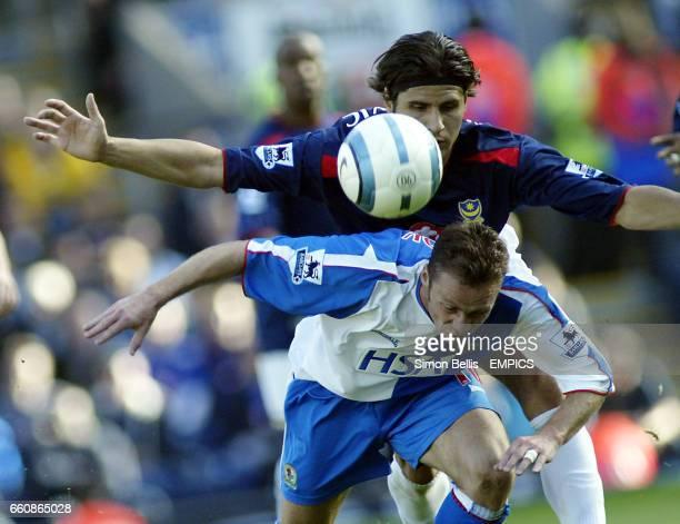 Blackburn Rovers' Paul Dickov and Portsmouth's Dejan Stefanovic