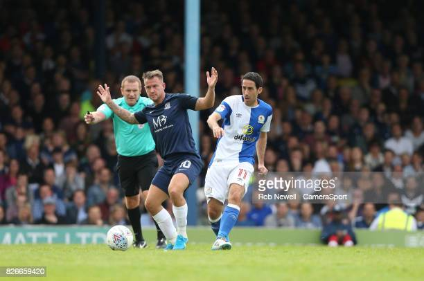 Blackburn Rovers' Peter Whittingham and Southend United's Simon Cox during the Sky Bet League One match between Southend United and Blackburn Rovers...