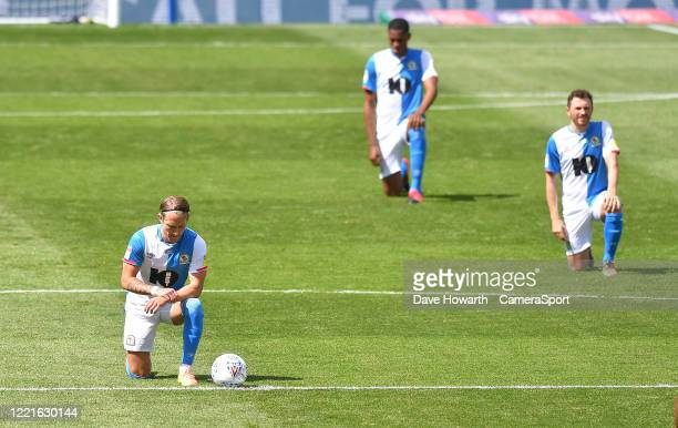 Blackburn Rovers players take the kneel during the Sky Bet Championship match between Blackburn Rovers and Bristol City at Ewood Park on June 20,...