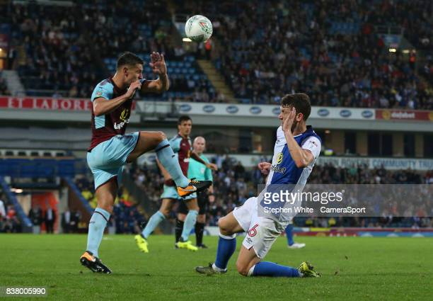 Blackburn Rovers' Richard Smallwood and Burnley's Ashley Westwood during the Carabao Cup Second Round match between Blackburn Rovers and Burnley at...