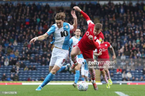 Blackburn Rovers' Sam Gallagher and Barnsley's Mads Juel Andersen of Blackburn Rovers during the Sky Bet Championship match between Blackburn Rovers...