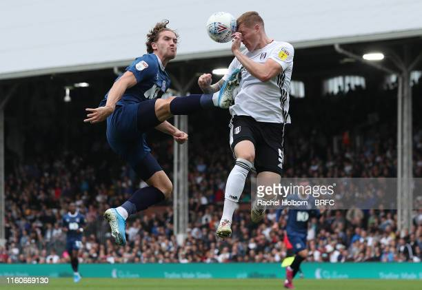 Blackburn Rovers' Sam Gallagher and Fulham's Alfie Mawson during the Sky Bet Championship match between Fulham and Blackburn Rovers at Craven Cottage...