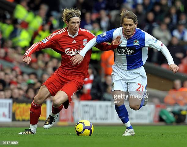 Blackburn Rovers' Spanish defender Míchel Salgado fights for the ball with Liverpool's Spanish forward Fernando Torres during their English Premier...