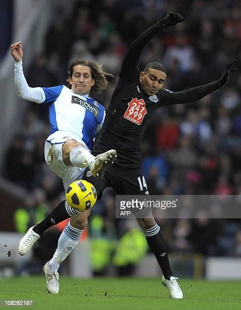 Blackburn Rovers' Spanish defender Míchel Salgado vies with West Bromwich Albion's English midfielder Jerome Thomas during the English Premier League...