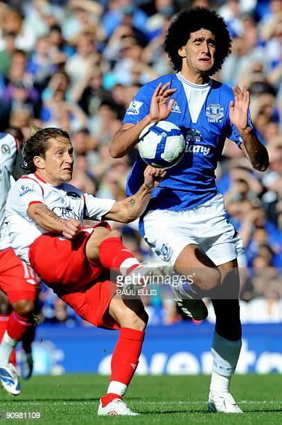 Blackburn Rovers' Spanish defender Michel Salgado clears the ball away from Everton's Belgian midfielder Marouane Fellaini during their English...