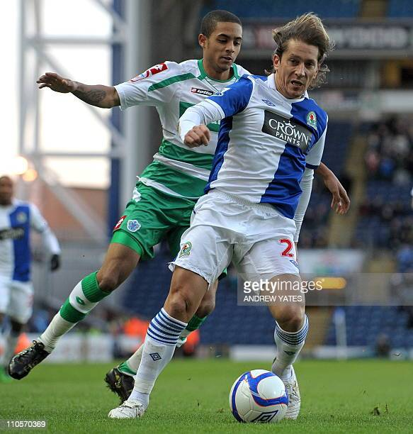 Blackburn Rovers' Spanish defender Michel Salgado vies with Queens Park Rangers' Portuguese midfielder Bruno Andrade during the FA Cup third round...