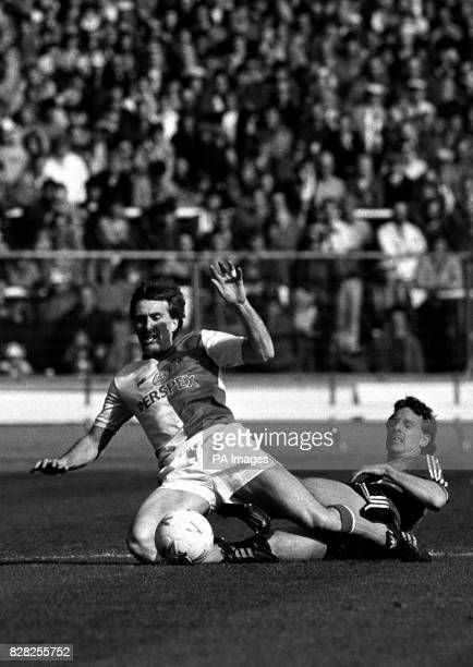 Blackburn Rovers striker Dusty Miller's attack on Charlton Athletic's goal bought to a halt by a sliding tackle from Charlton defender Steve Thompson