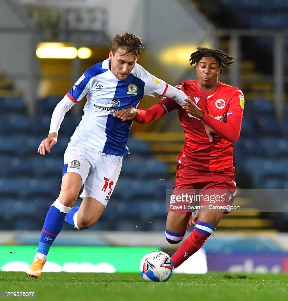 Blackburn Rovers' Tom Trybull battles with Reading's Michael Olise during the Sky Bet Championship match between Blackburn Rovers and Reading at...