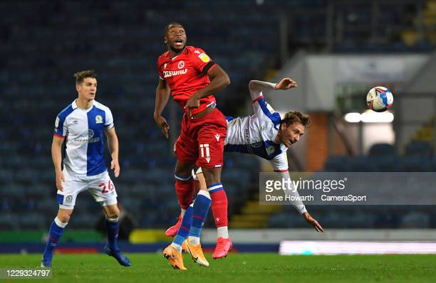 Blackburn Rovers' Tom Trybull battles with Reading's Yakou Meite during the Sky Bet Championship match between Blackburn Rovers and Reading at Ewood...