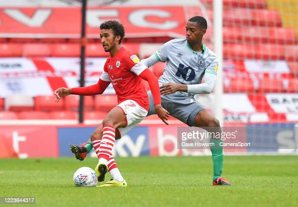 Blackburn Rovers' Tosin Adarabioyo battles with Barnsley's Jacob Brown during the Sky Bet Championship match between Barnsley and Blackburn Rovers at...