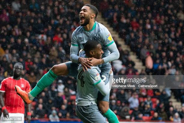 Blackburn Rovers' Tosin Adarabioyo celebrates scoring his side's second goal with team-mate Dominic Samuel during the Sky Bet Championship match...