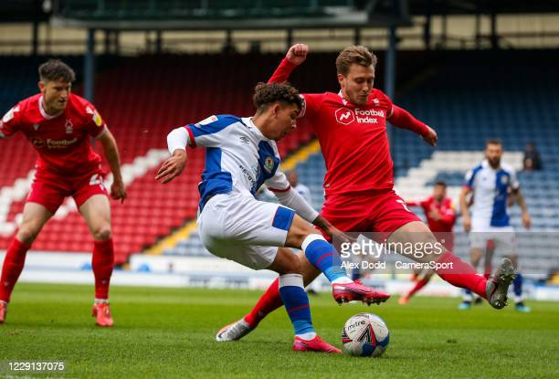 Blackburn Rovers' Tyrhys Dolan tries to cross under pressure from Nottingham Forest's Luke Freeman during the Sky Bet Championship match between...