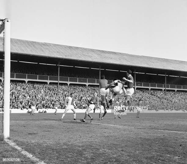 Blackburn Rovers v Manchester United league match at Ewood Park Saturday 3rd April 1965 Keeper Pat Dunne punches ball clear from Byrom Foulkes goes...