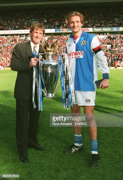 Blackburn Rovers'Kenny Dalglish and Tim Sherwood celebrate with the FA Carling Premiership trophy