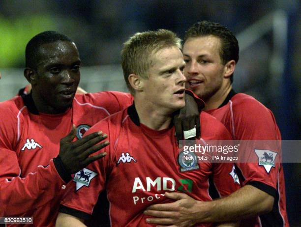 Blackburn Rovers's Damien Duff celebrates with Dwight Yorke and Lucas Neil after scoring the 2nd goal during the FA Barclaycard Premiership game at...