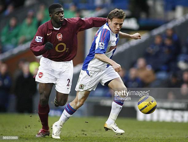 Blackburn, UNITED KINGDOM: Blackburn Rover's Craig Bellamy avoids the tackle of Arsenal's Kolo Toure during their English Premiership soccer match at...