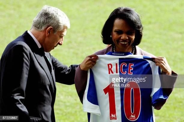 US Secretary of State Condoleezza Rice holds a Blackburn Rovers football team shirt next to British Foreign Secretary Jack Straw at Blackbrurn...