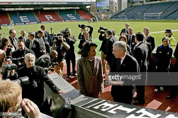 US Secretary of State Condoleezza Rice listens to Britain's Foreign Secretary Jack Straw at Ewood Park the stadium of Blackburn Rovers soccer team in...