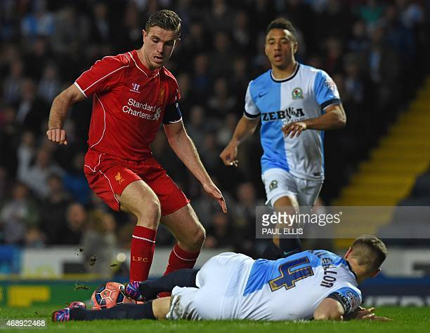 Blackburn's English defender Matthew Kilgallon vies with Liverpool's English midfielder Jordan Henderson during the English FA Cup quarterfinal...