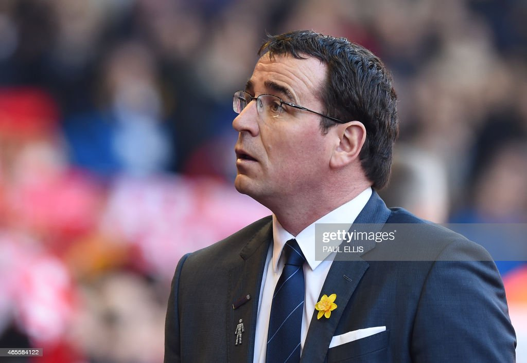 Blackburn's English manager Gary Bowyer arrives for the FA Cup quarter-final match between Liverpool and Blackburn Rovers at Anfield in Liverpool, north west England on March 8, 2015. OR 'LIVE' SERVICES. ONLINE IN-MATCH USE LIMITED TO 45 IMAGES, NO VIDEO EMULATION. NO USE IN BETTING, GAMES OR SINGLE CLUB/LEAGUE/PLAYER PUBLICATIONS. / AFP PHOTO / Paul ELLIS
