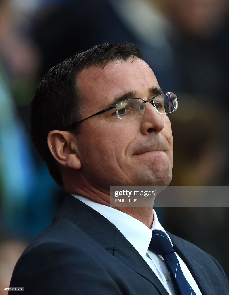Blackburn's English manager Gary Bowyer looks on ahead of the English FA Cup quarter-final replay football match between Blackburn Rovers and Liverpool at Ewood Park in Blackburn, north west England on April 8, 2015. PHOTO / Paul ELLIS