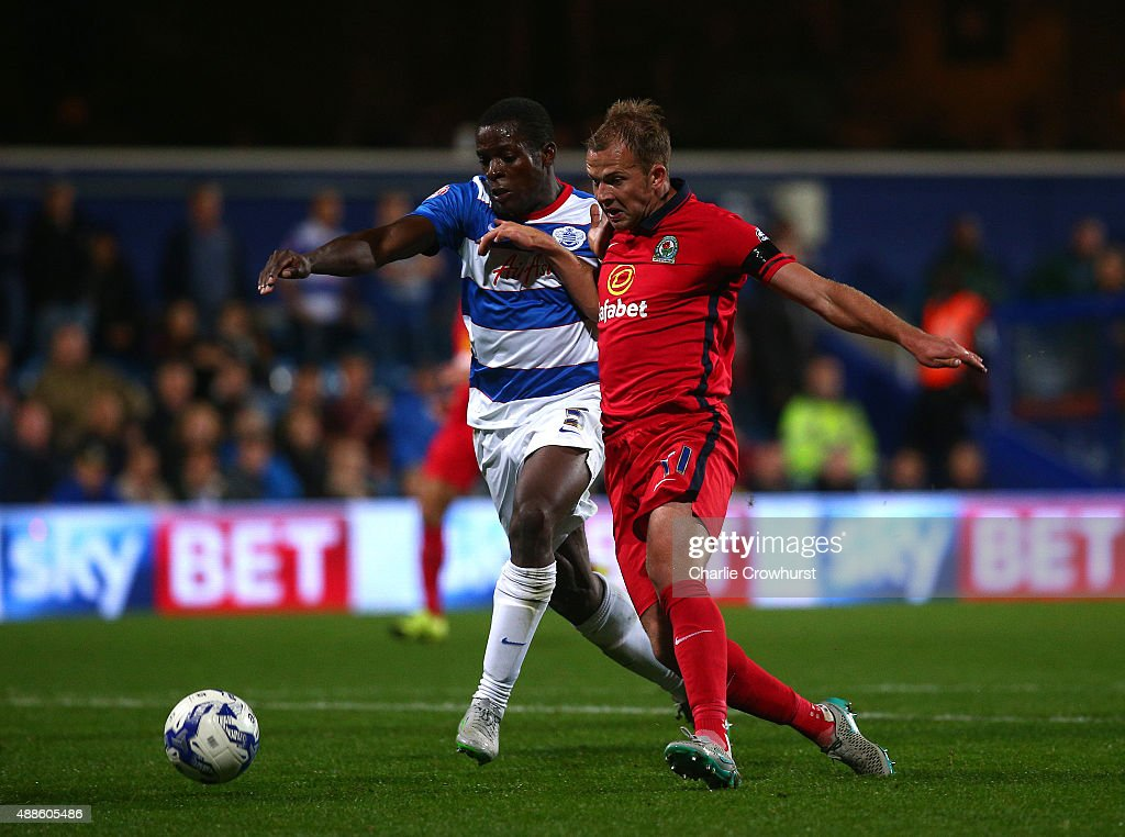 Blackburn's Jordan Rhodes holds off QPR's Nedum Onuoha during the Sky Bet Championship match between Queens Park Rangers and Blackburn Rangers at Loftus Road on September 16, 2015 in London, England.