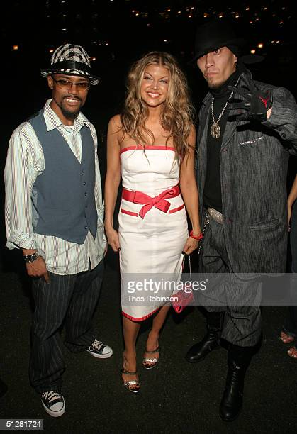 Blacked Eye Peas arrive to the Tommy Hilfiger show during Olympus Fashion Week Spring 2005 in Bryant Park September 9 2004 in New York City