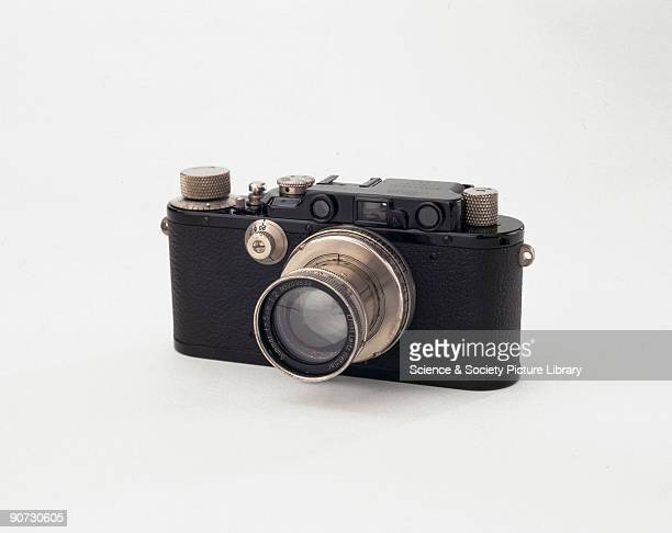 A blackenamelled Leica III with a screw mount for interchangeable lenses and a builtin coupled rangefinder with a magnifying eyelens This was the...