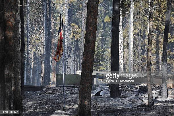 Blackened and charred homes are seen along Herring Road in the Black Forest area northeast of Colorado Springs CO on June 12 2013 Temperatures are...