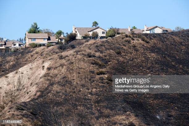 Blackened hillsides right up to the back of homes in the Stone Crest neighborhood after the Tick fire roared through the area in Canyon Country CA...