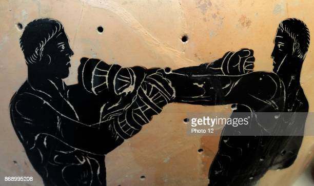 Blackfigured Panathenaic amphora showing a boxing contest Greek made in Athens for the Panathenaic festival 336 BC From Cervetri Italy