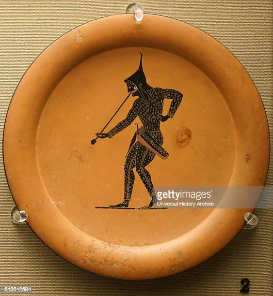 Blackfigured plate depicts an archer blowing a trumpet made in Athens Dated 6th Century BC