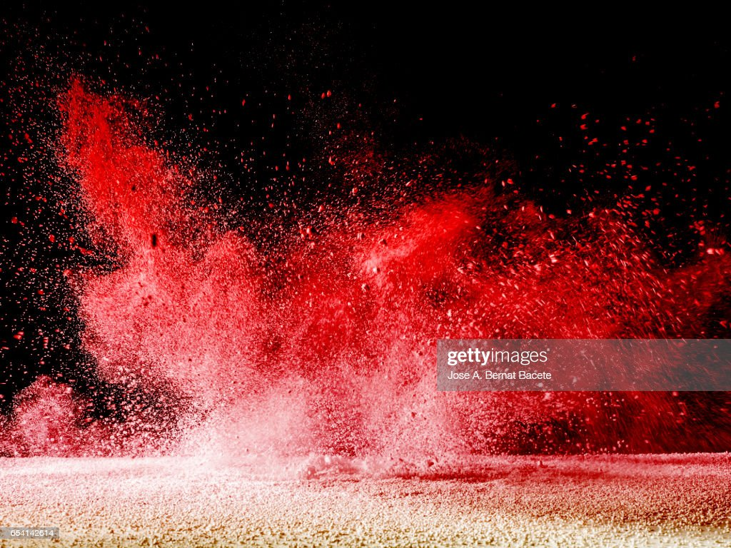 Blackground of particles of white powder in ascending movement floating in the air produced by an impact : Stock Photo