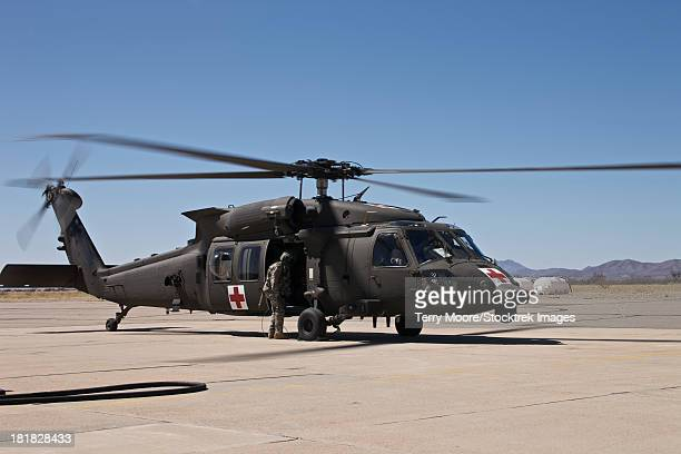 A UH-60 Blackhawk finishes refueling and prepares to taxi away to continue its mission, Davis Monthan Air Force Base, Arizona.