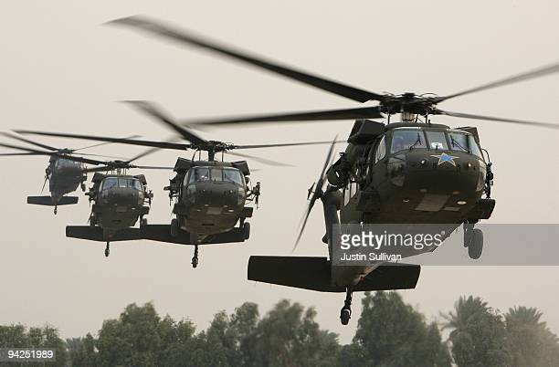 Blackhawk helicopter carrying US Secretary of Defense Robert Gates arrives in the Green Zone December 10 2009 in Baghdad Iraq Secretary Gates stopped...