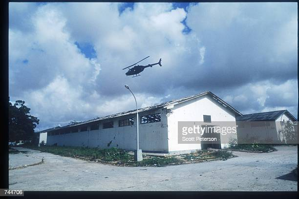 Blackhawk helicopter flies during the attack on warlord Aidid December 6 1993 in Mogadishu Somalia US gunships attacked the compound of warlord...