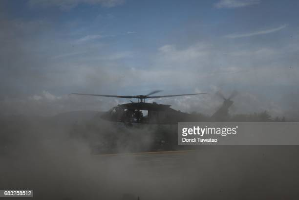 Blackhawk helicopter lands at a port to disembark personnel and supplies on May 15 2017 in Casiguran Province Philippines Philippines and US troops...