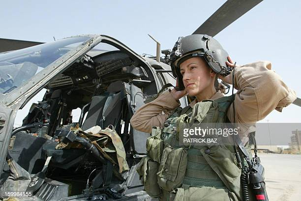 Blackhawk helicopter pilot of the 2501st Aviation Regiment 4th Brigade 1st Armoured Division Chief Warrant Officer Charlene Frie prepare her gear at...