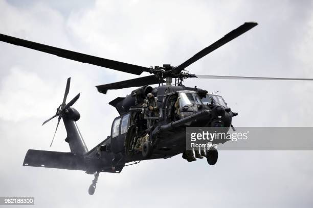 Blackhawk helicopter piloted by the US Army's 160th Special Operations Aviation Regiment flies overhead during an International Special Operations...