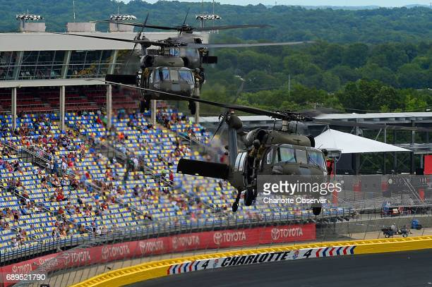 Blackhawk helicopters fly over the infield of Charlotte Motor Speedway on Sunday May 28 2017 prior to the running of the CocaCola 600 race